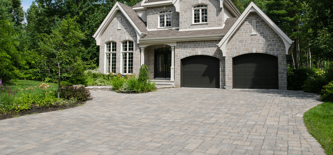 A beautiful concrete paver driveway installation