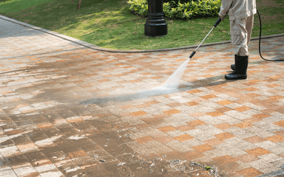 Powerwashing an interlocking paver driveway