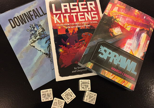 Insert Picture of Dungeon Morph Dice, Downfall RPG, Lazer Kittens RPG, and The Sprawl RPG