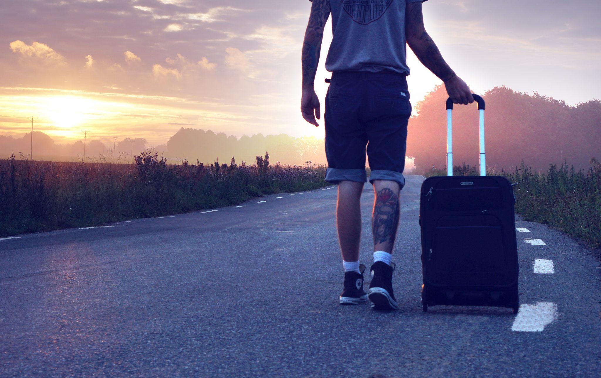 man-suitcase-road