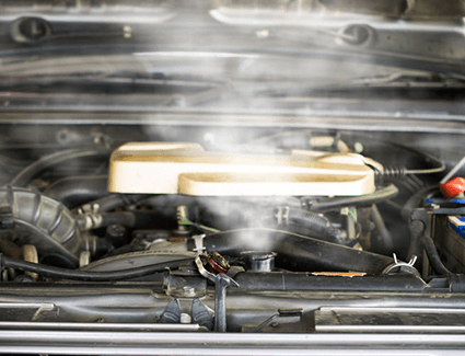 Steam comes from a radiator in a vehicle's engine