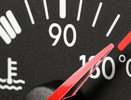 The needle in a temperature gauge points to an excessively high temperature