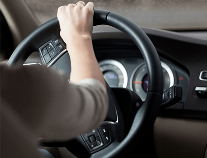 Person turning steering wheel