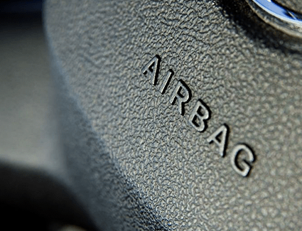 Close-up of steering wheel airbag