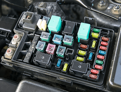 The fuse box inside a vehicle.