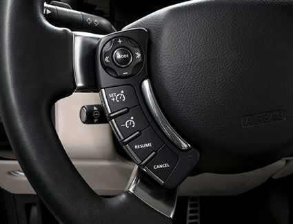 The steering wheel of a vehicle, showing the controls for cruise control.