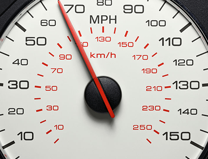 A car's speedometer showing a travel speed of around 70 miles per hour.