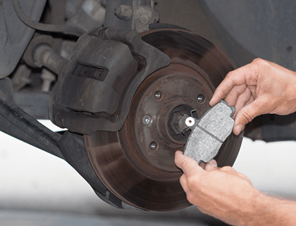 The brake pad shown here has properly bedded in with the rotor for smooth, quiet stopping power