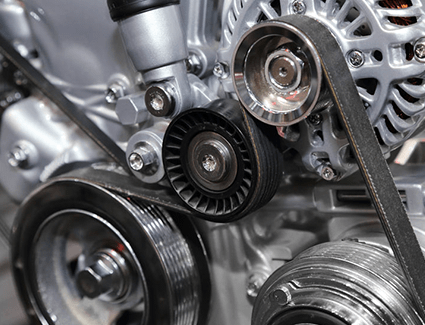 A serpentine belt winds around various pulleys to power the engine's important accessories