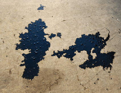 Engine oil leaks can show up as dark drips under your car