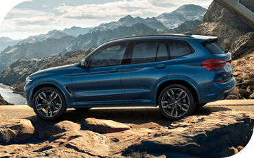 BMW X3 driving on rocky road