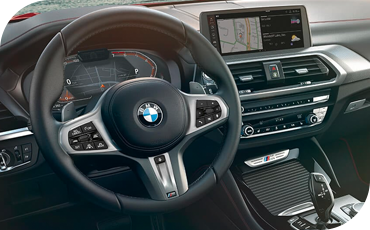BMW X4 interior with Live Cockpit Professional showing