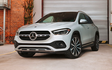 White Mercedes-Benz GLA parked and ready to hit the road.