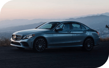 With its sculpted side panels and long hood, the new C-Class projects a powerful look on the road