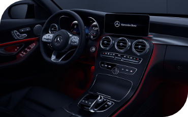 Shown here in red, available ambient lighting lends a premium touch to the interior of the new C-Class