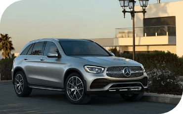 Silver Mercedes-Benz GLC parked safely at home