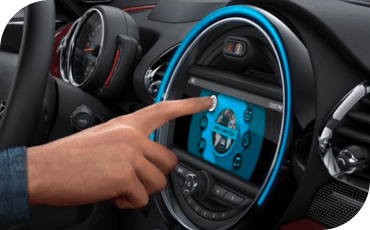 Person pressing the touchscreen in a MINI Hardtop 2 Door