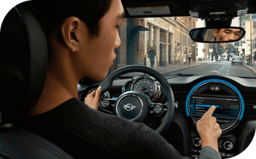 Person driving a 2020 MINI Cooper Hardtop 4 Door and using the touchscreen