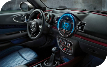The available touchscreen multimedia system is encircled in a blue LED light ring for a distinct MINI style both inside and out