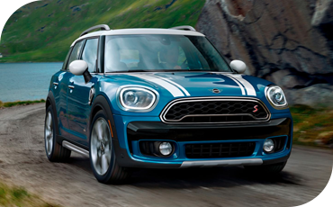 Rounded LED headlights and fog lights prepare your MINI Countryman for adventure, day or night