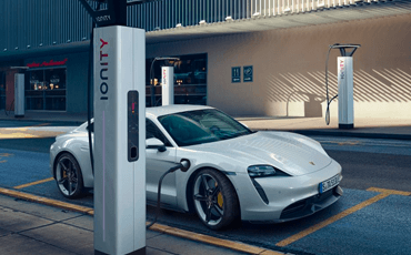 A Porsche Taycan charges at a high-powered public charging facility, one of the fastest ways to recharge the vehicle's batteries