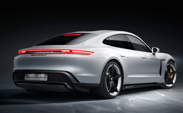 The striking design of the Porsche Taycan includes a seamless light strip and an adaptive three-stage rear spoiler