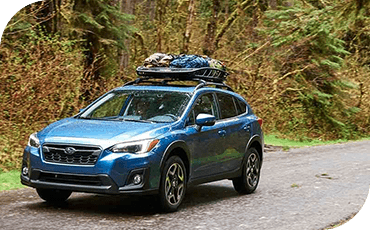 Headed to the campsite, this Crosstrek carries extra cargo in a cargo box on its roof.