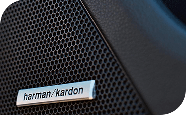 A close-up view of a Harman Kardon speaker in a 2019 Subaru Legacy.
