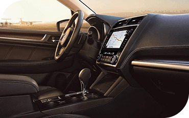 Compare 2019 Subaru Legacy vs Toyota Camry interior styling features.