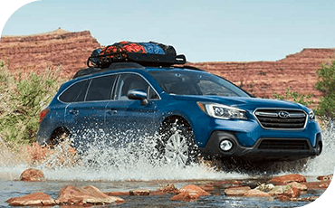 Standard all-wheel drive and plenty of ground clearance helps this Outback easily ford a stream.