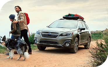 A family explores their destination, having arrived safely in the 2019 Subaru Outback.