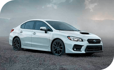 A 2020 Subaru WRX on a gravel area.
