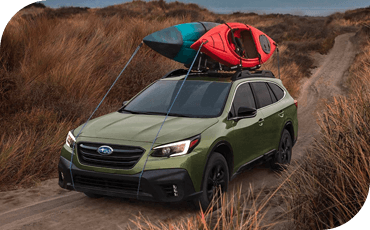 This Subaru Outback carries a pair of kayaks, showing off its cargo flexibility