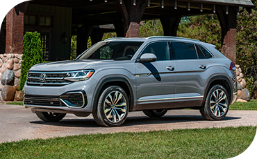 2020 VW Atlas Cross Sport parked outside of a house