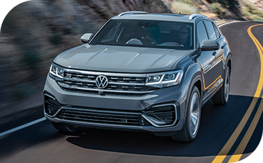 2020 VW Atlas Cross Sport driving quickly down a road