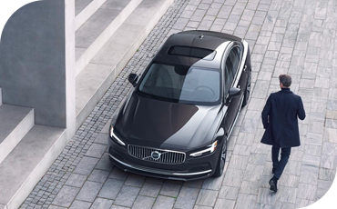 Man walking by a new Volvo S90