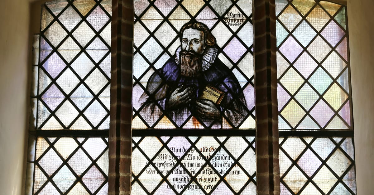 photo of stained glass window depicting Martin Rinkart
