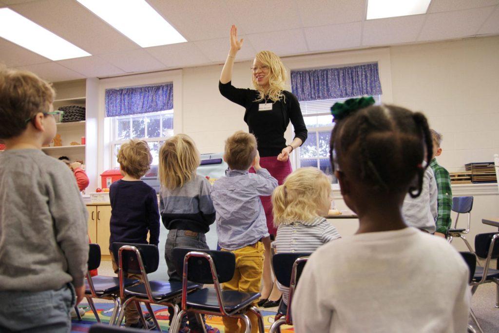 teacher leads children in class