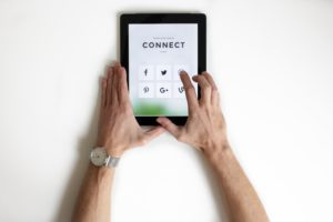 image of hands holding iPad