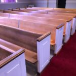 pews from the 1970 expansion do not match the original pews