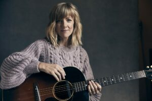 Photo of Sandra McCracken with guitar