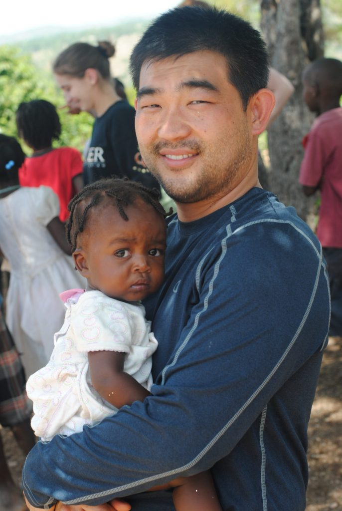 2014 Team Haiti 4 - Peter with girl photo from Peter Sim