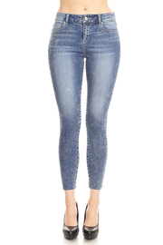 Mid-rise 5-pocket ankle skinny with whiskers, hand sanding &grindings One button closure, zip fly.