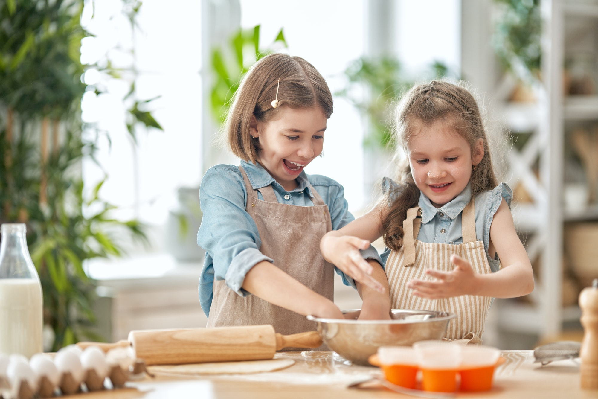 girls are cooking cookies