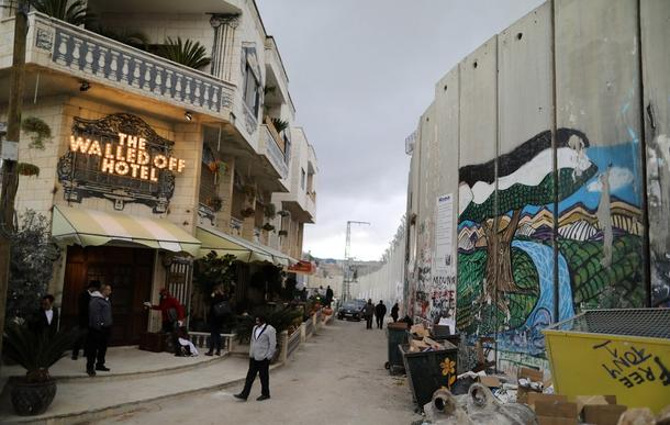 Graffiti artist Banksy has opened a hotel in the West Bank. The Walled Off Hotel features artworks exploring the Israel-Palestine conflict.