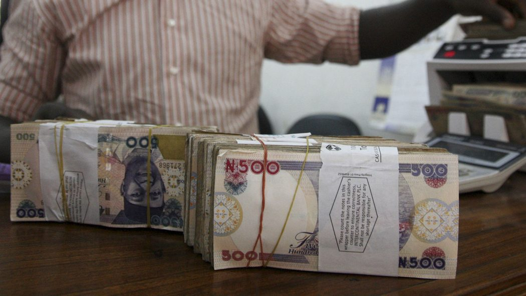 spraying naira notes