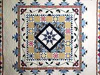 Navy and Pastel Feathered Edge Star Medallion Quilt