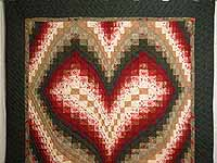 Dark Green Brick and Tan Bargello Heart Quilt