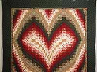 Dark Green Brick and Tan Bargello Heart Quilt