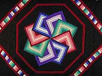 Black Background Star Spin Quilt